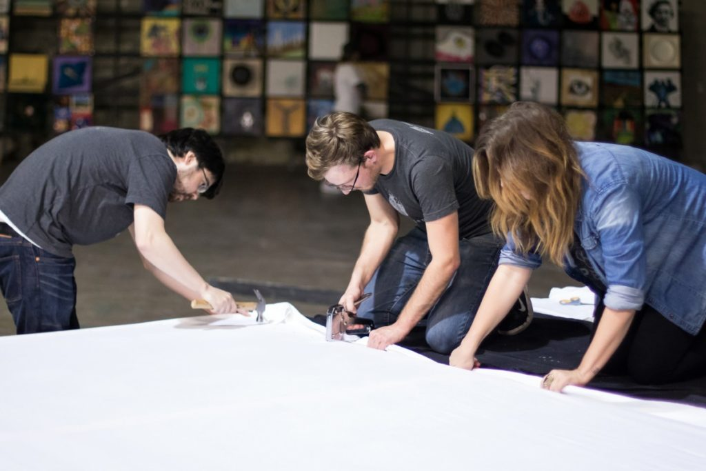 Team working to setup for Art Con